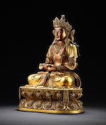 A rare Imperial gilt-lacquered bronze figure of Amitayus Kangxi