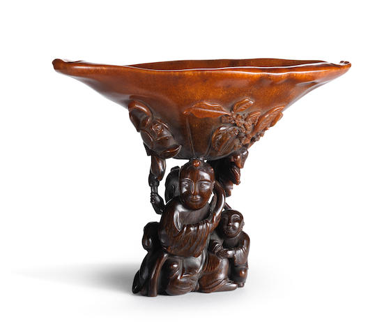 An exceptionally rare rhinoceros horn 'boys and goat' libation cup 17th/18th century
