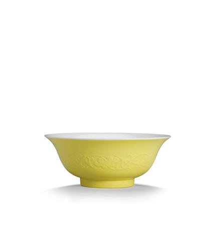 A very rare moulded lemon-yellow and famille rose bowl Yongzheng six-character mark and of the period (2)