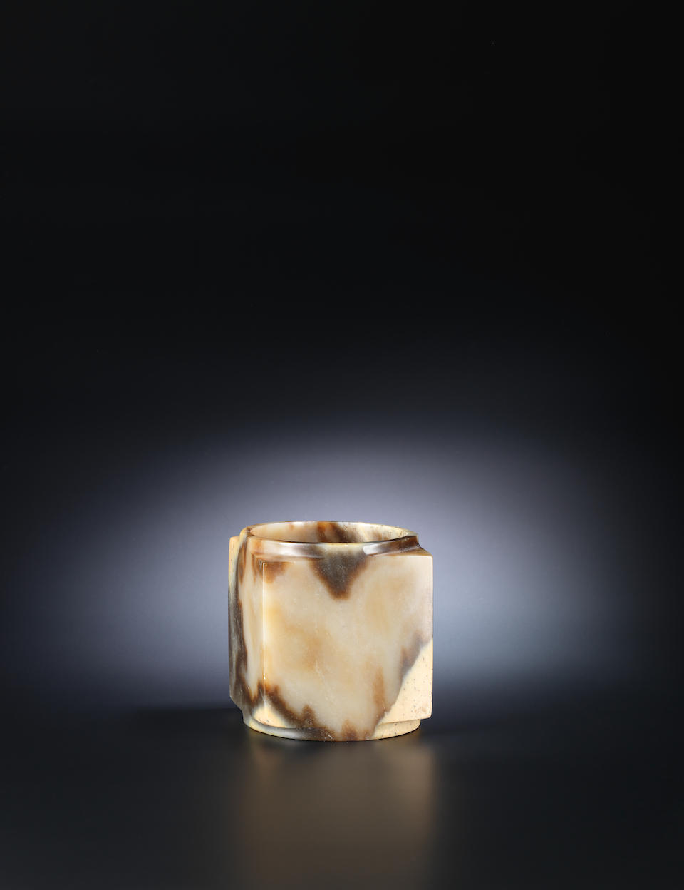 A mottled yellow and brown jade cylindrical vessel, cong Neolithic Period or later