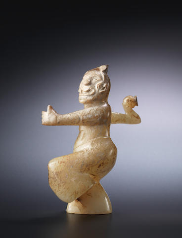 A rare pale green jade figure of a male dancer Eastern Han Dynasty