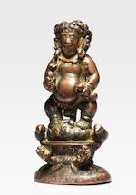 A COPPER COMPOSITE FIGURE OF VAJRAPANI AND KUBERA ATTRIBUTED BY INSCRIPTION TO THE TENTH KARMAPA, CHOYING DORJE (1604-1674)