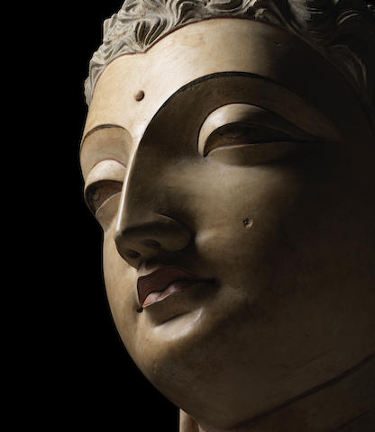 A POLYCHROMED STUCCO HEAD OF BUDDHA ANCIENT REGION OF GANDHARA, CIRCA 4TH/5TH CENTURY