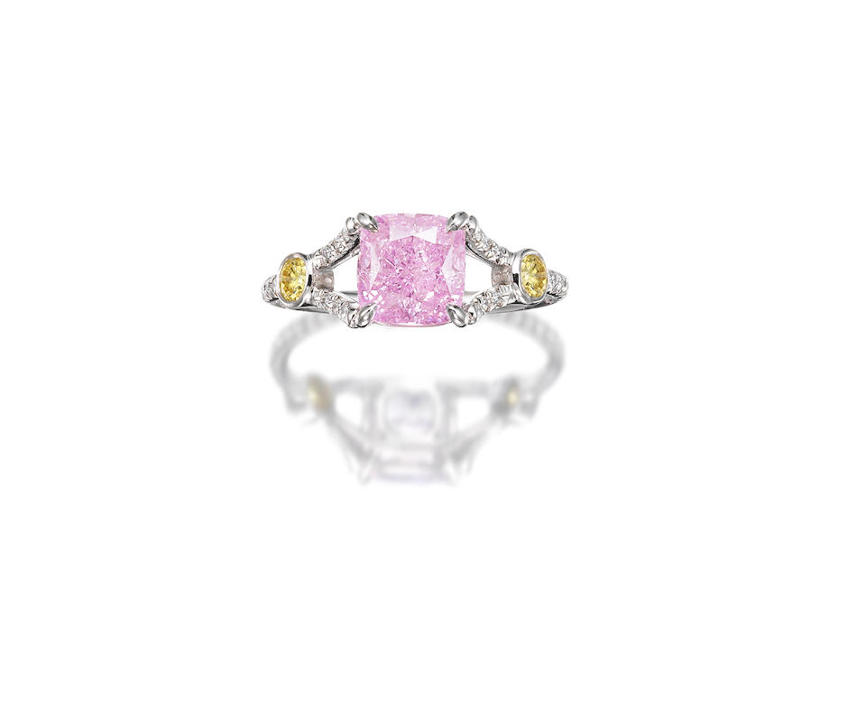 An Extremely Rare Fancy Coloured Diamond and Diamond Ring