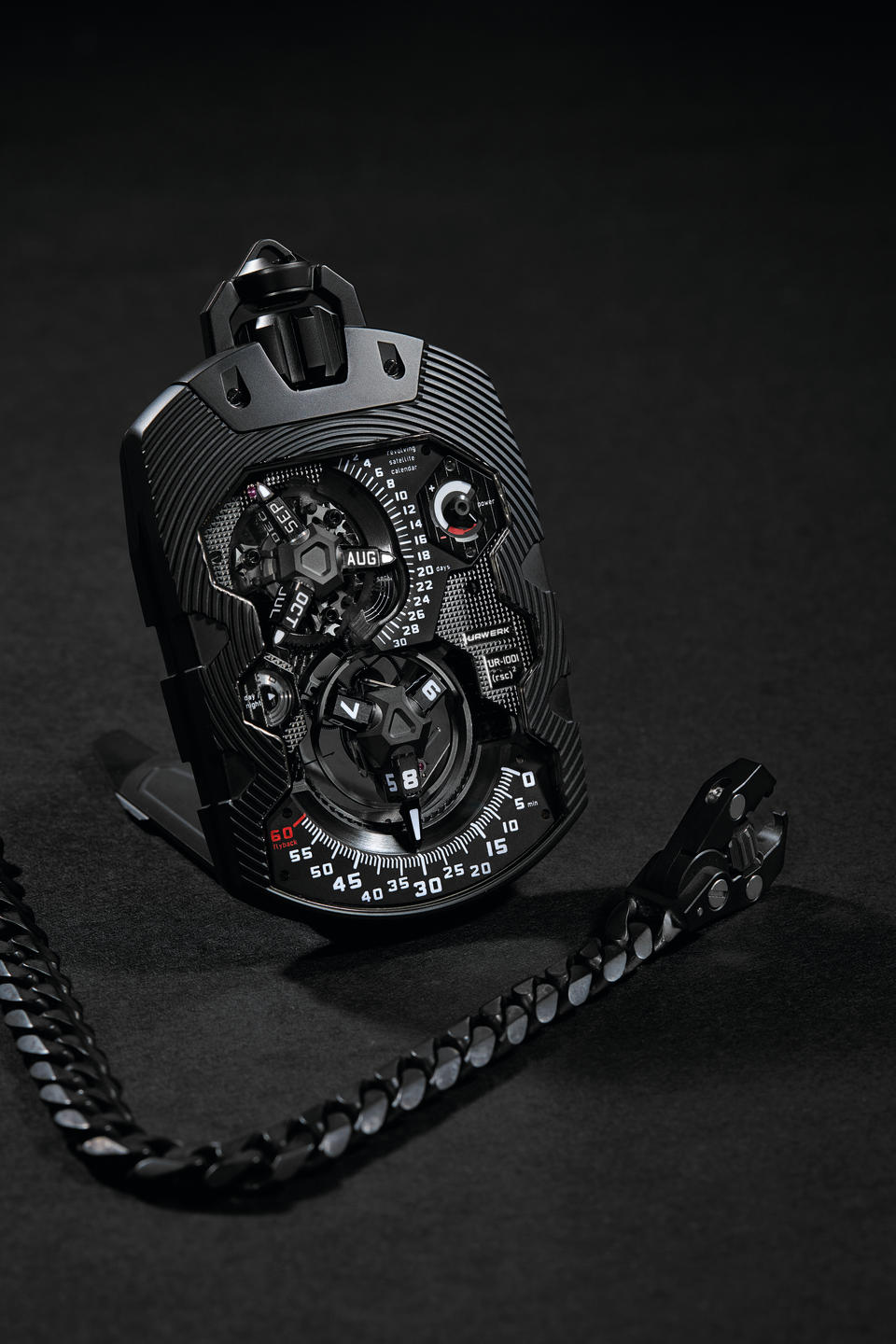 "Urwerk, An Exceptionally Rare, Limited Edition AlTiN Coated Stainless Steel Automatic Annual Calendar Watch with Revolving Satellite Hour and Month Displays, Retrograde Minutes and Date, Day-Night, Power Reserve Indication, ""Oil Change"", 100-year and 1000-year indicator, UR-1001 ""Zeit Device Über Complication"" Limited to 8 pieces, Circa 2012"