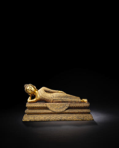 A COPPER ALLOY AND LACQUER GILT FIGURE OF THE BUDDHA IN PARINIRVANA Bangkok/Rattanakosin first period 1782-1851 CE