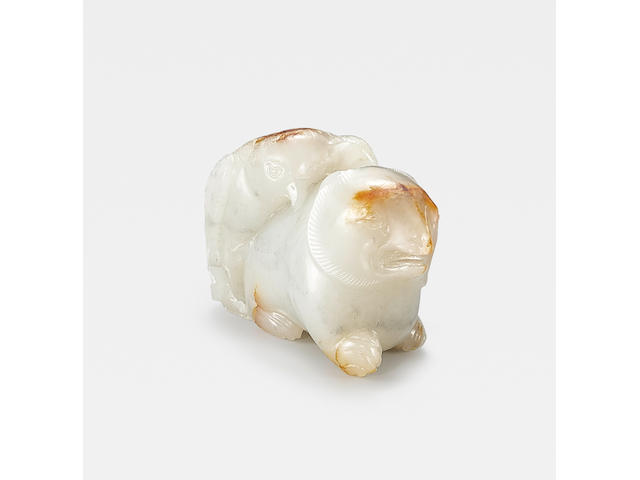 An exceptionally rare white and russet jade 'eagle and bear' group Ming Dynasty or earlier
