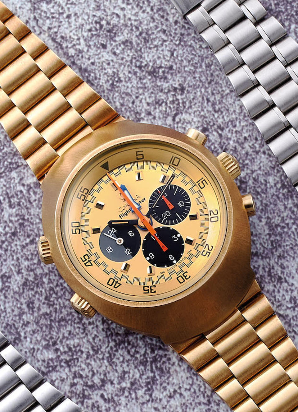 Omega. A Fine and Rare Yellow Gold Chronograph Pilot's Bracelet Watch with Inner Rotating Bezel and Second Time Zone, With extract