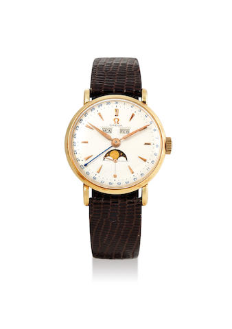 Omega. A Yellow Gold Triple Calendar Wristwatch with Moon Phases