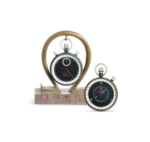 Two Omega Watches. A Stainless Steel Split Second Calendar Stop Watch, A Stainless Steel Open Face 1/10th Second Stop Watch, With a stand