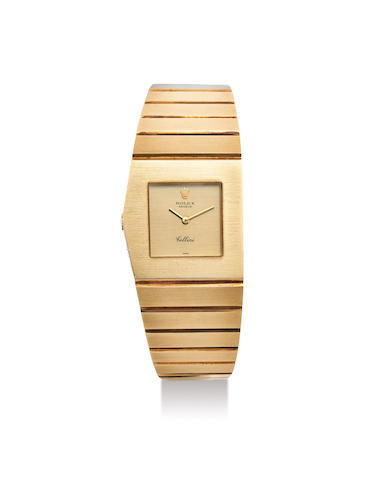Rolex. A Mid-Size Yellow Gold Left-Handed Asymmetrical Bracelet Watch