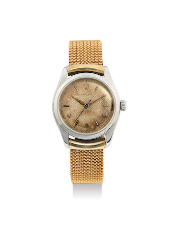 Rolex. A Rare Stainless Steel Tonneau Form Bracelet Watch With Honeycomb Dial and Rolex Coronet Numerals