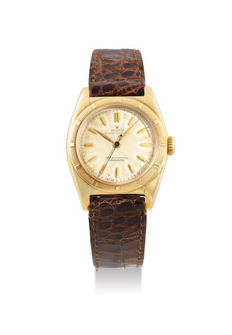 Rolex. A Yellow Gold Bubbleback Chronometer Wristwatch