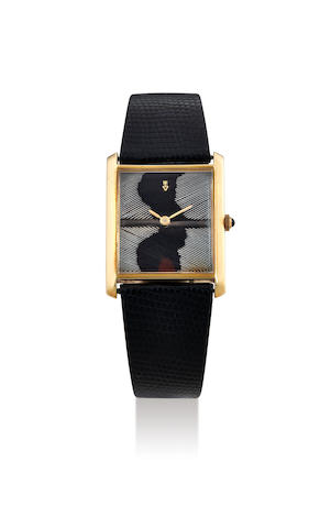 Corum. A Rare Yellow Gold Wristwatch with Feather Dial