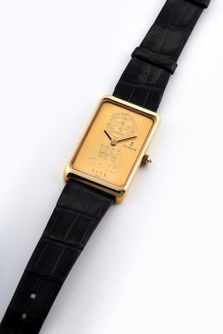 Corum. A Yellow Gold Ingot Wristwatch