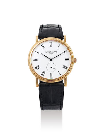 Patek Philippe. A Yellow Gold Wristwatch, Ref. 5119J, With Extract from the Archives and presentation box