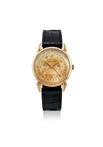 Movado. A Yellow Gold Wristwatch with Day and Date