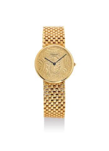 Chopard. A Yellow Gold Bracelet Watch with Decoratively Engraved Gold Dial