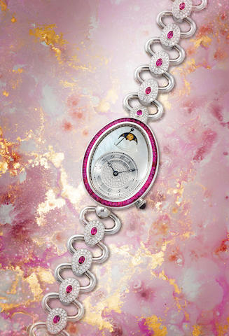 Breguet. An Exceptionally Rare Lady's White Gold, Diamond and Ruby Set Oval Bracelet Watch with Moon-Phases, Power Reserve and Mother-of-Pearl Dial