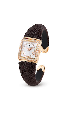 De Grisogono. A Lady's Pink Gold and Diamond Set Bangle Watch