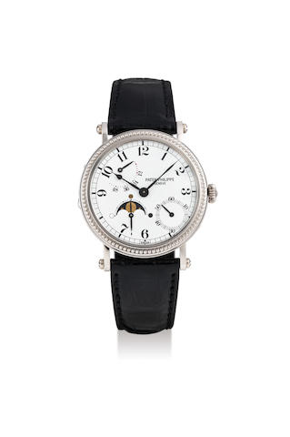 Patek Philippe. A White Gold Wristwatch with Power Reserve and Moon Phases