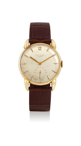 Patek Philippe. A 18k yellow gold wristwatch, with extra strap