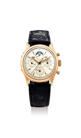 Universal Genève. A Yellow Gold Triple Calendar Chronograph Wristwatch with Moon-Phases and 'Panda Dial'