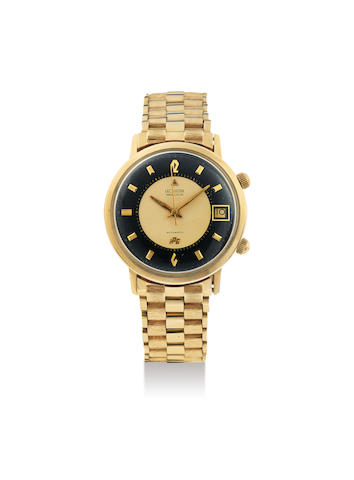 LeCoultre. A Rare Yellow Gold Centre Seconds Alarm Wristwatch with Date, Champagne and Black Dial