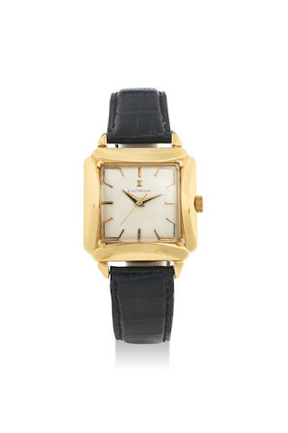 E. Gübelin. A Fine Yellow Gold Square Centre Seconds Wristwatch