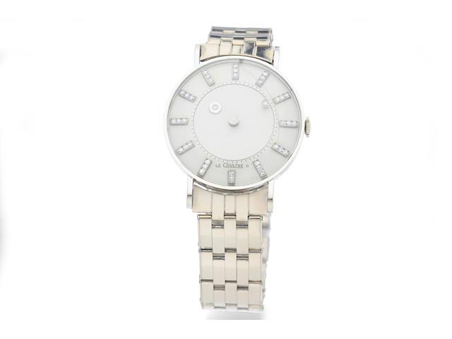 LeCoultre. A 14K White Gold Diamond-Dial 'Mystery' Bracelet Watch