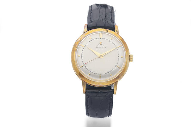 Gübelin. A Yellow Gold Wristwatch with Milled Band and Two-Tone Dial