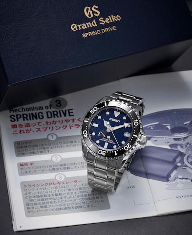 Grand Seiko. A Titanium Limited Edition Automatic Diver's Calendar Bracelet Watch, 'Spring Drive' Ref.SBGA071, No.020/200, With Box, Guarantee and Manual