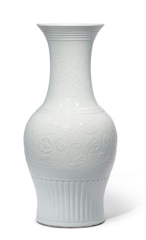 A very rare and large white-glazed relief-decorated vase Yongzheng seal mark and of the period (2)