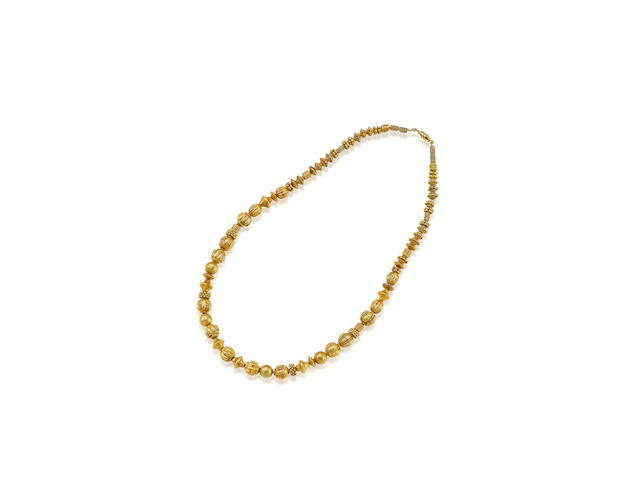 A GOLD BEAD NECKLACE  BURMA,